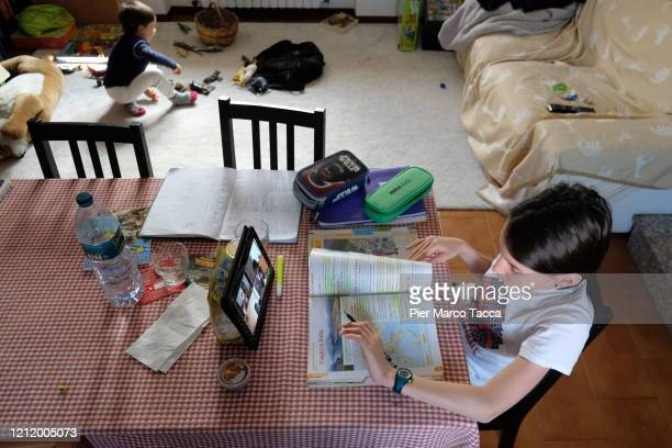 Fourth grade student Nicolo son of the photographer uses a tablet to participate in an Elearning class with his teacher and classmates while at home...
