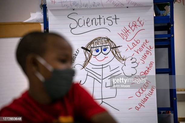 Fourth grader takes part in a math and science class at Stark Elementary School on September 16, 2020 in Stamford, Connecticut. Most students at...