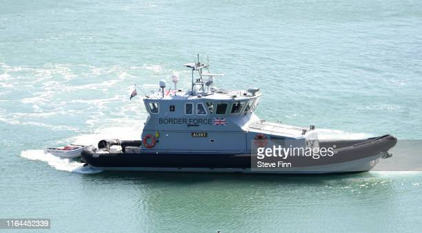 Fourth migrant boat is brought ashore by the UK Border Force on August 22, 2019 in Dover, England. In total six boats arrived to the Kent coast...