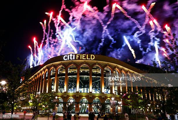 Fourth of July fireworks explode after the New York Mets defeated the Texas Rangers 65 on July 4 2014 at Citi Field in the Flushing neighborhood of...