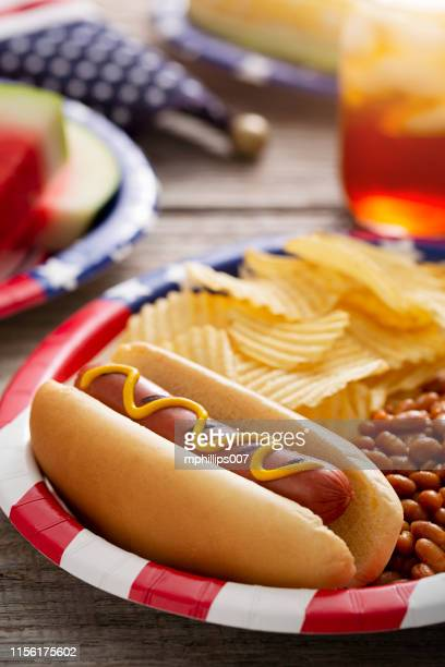 fourth of july holiday hot dog backyard barbecue - corn on the cob stock pictures, royalty-free photos & images