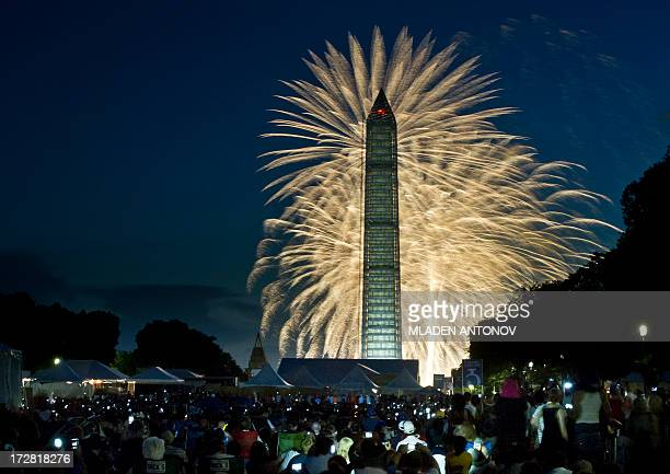 Fourth of July Independence Day fireworks are seen over the Washington Monument July 4 2013 in Washington DC AFP PHOTO / MLADEN ANTONOV