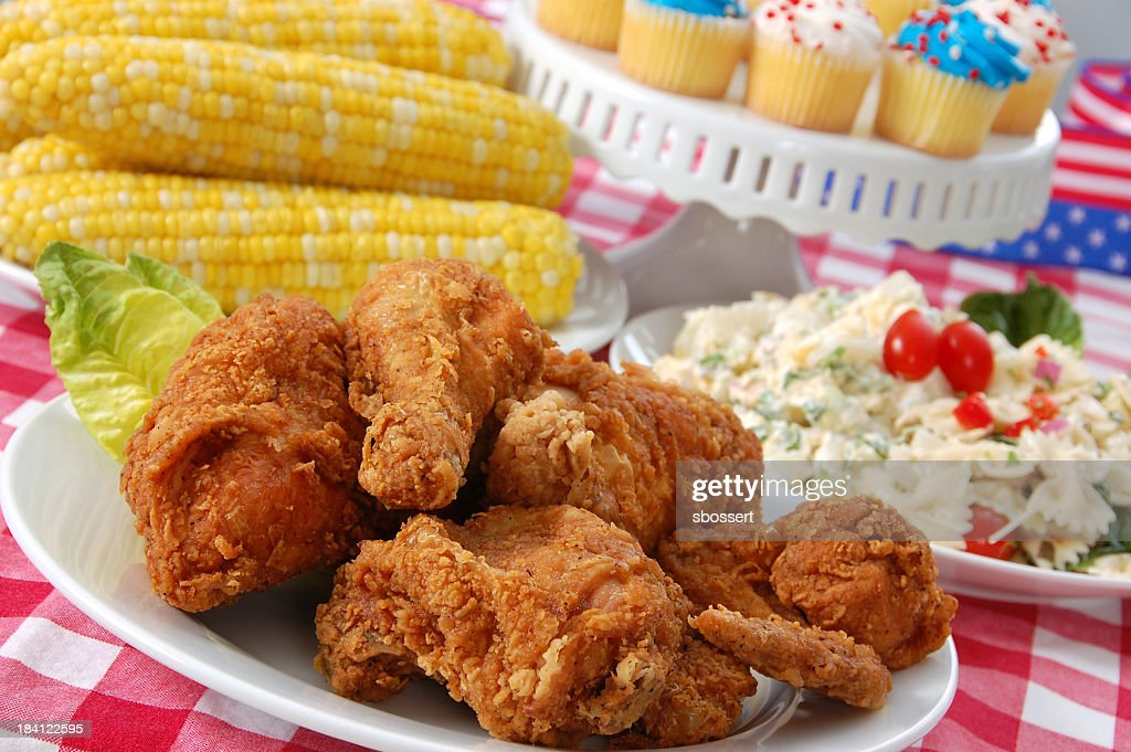 Fourth of July Picnic with chicken, corn and cupcakes : Stock Photo