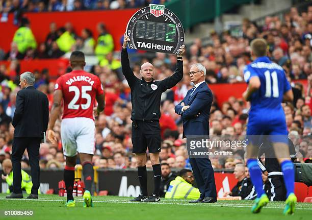 Fourth offical Lee Mason holds up the mintues of extra time during the Premier League match between Manchester United and Leicester City at Old...