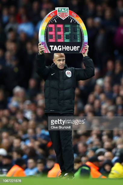 Fourth Official Anthony Taylor holds up the electronic substitute board during the Premier League match between Manchester City and AFC Bournemouth...
