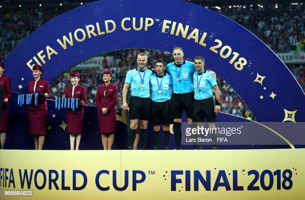 Fourth official Bjorn Kuipers, Assistant referee Juan Pablo Belatti, Referee Nestor Pitana and Assistant referee Hernan Maidana pose with the medals...