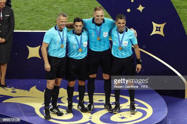 Fourth official Bjorn Kuipers Assistant referee Juan Pablo Belatti Referee Nestor Pitana Assistant referee Hernan Maidana pose with medals for their...