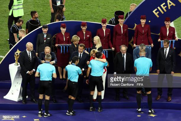 Fourth official Bjorn Kuipers Assistant referee Juan Pablo Belatti Referee Nestor Pitana and Assistant referee Hernan Maidana receive their medals...
