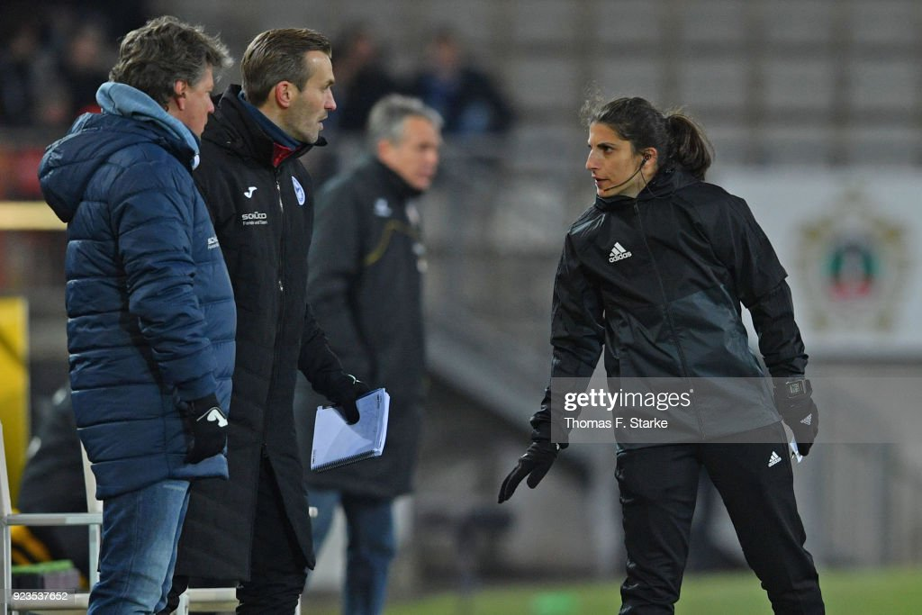 Fourth official Dr. Riem Hussein (R) argues with coach Jeff Saibene (L) and assistant coach Carsten Rump of Bielefeld during the Second Bundesliga match between DSC Arminia Bielefeld and SG Dynamo Dresden at Schueco Arena on February 23, 2018 in Bielefeld, Germany.