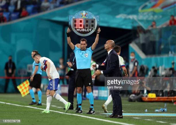 Fourth Official, Fernando Andres Rapallini raises the substitute board for Yuri Zhirkov of Russia to be replaced by Vyacheslav Karavaev during the...