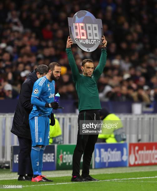 Fourth Official Guillermo Cuadra Fernandez uses the Hublot LED board to show Gonzalo Higuain of Juventus being substituted on during the UEFA...