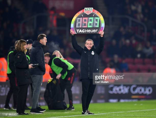Fourth official holds up a Stonewall Rainbow Laces branded substitution board during the Premier League match between Southampton FC and Norwich City...