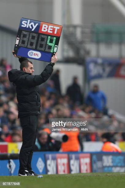 Fourth Official holds up The SkyBet football league substitutes / injury time board showing four minutes remaining during the Sky Bet League One...