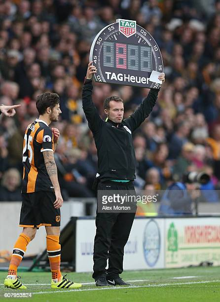 Fourth official holds up the substitution board during the Premier League match between Hull City and Arsenal at KCOM Stadium on September 17 2016 in...