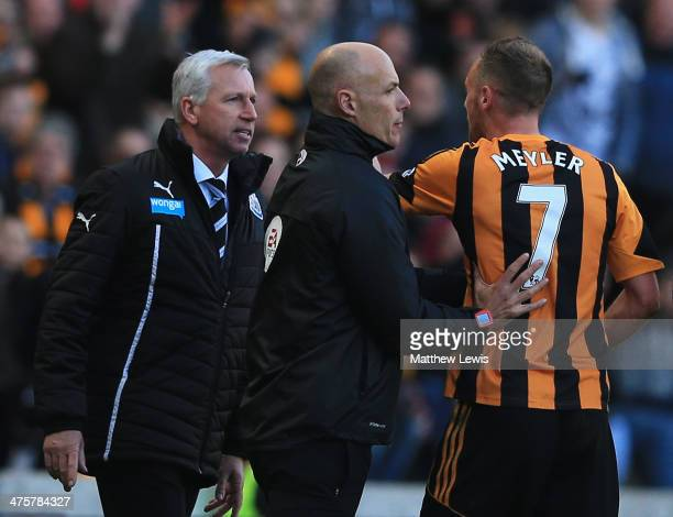 Fourth official Howard Webb restrains David Meyler of Hull City after a clash with Alan Pardew manager of Newcastle United during the Barclays...