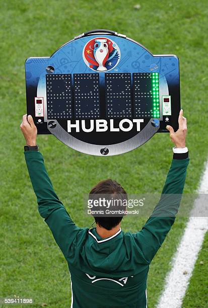 Fourth official indicates one minute of extra time before the half time during the UEFA EURO 2016 Group B match between Wales and Slovakia at Stade...