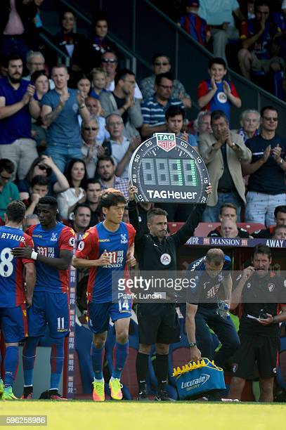 Fourth Official James Adcock of United Kingdom indicates a substition during the Premier League match between Crystal Palace and Bournemouth at...