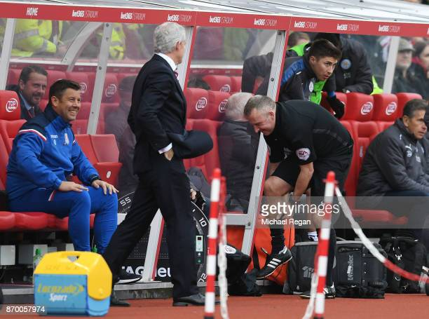 Fourth official Jon Moss prepares to replace referee Robert Madley during the Premier League match between Stoke City and Leicester City at Bet365...