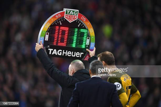 Fourth official Jonathan Moss holds up the electronic substitute board during the Premier League match between Huddersfield Town and Brighton Hove...