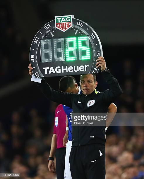 Fourth official Kevin Friend holds an electronic board as he oversees a substitution during the Premier League match between Everton and Crystal...