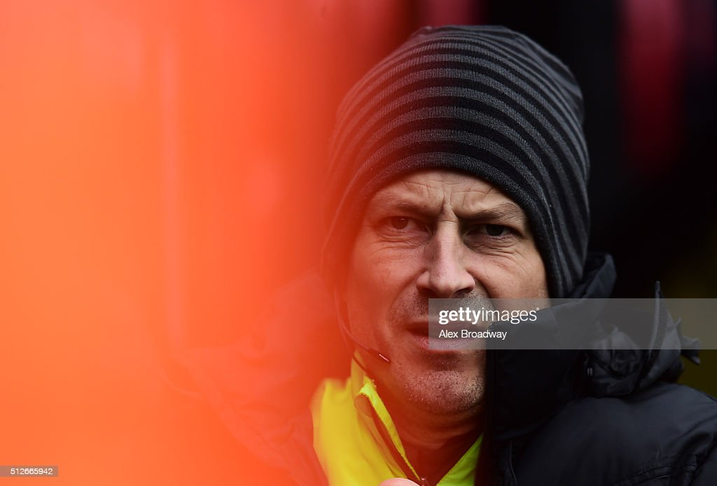 Fourth Official Mark Clattenburg looks on prior to the Barclays Premier League match between Watford and A.F.C Bournemouth at Vicarage Road on February 27, 2016 in Watford, England.
