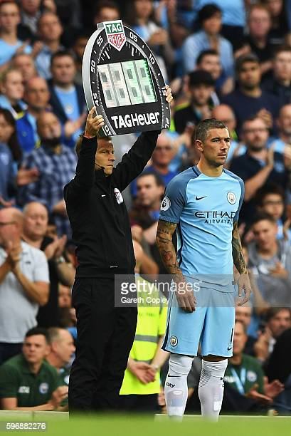 Fourth official Mike Jones holds the electronic board as Aleksander Kolorov of Manchester City comes on as a substitute during the Premier League...