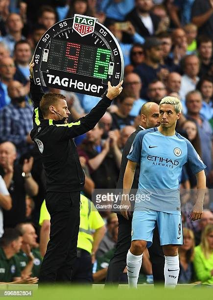 Fourth official Mike Jones holds the electronic board as Samir Nasri of Manchester City comes on as a substitute during the Premier League match...