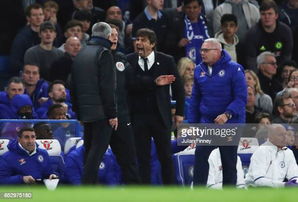 Fourth official Mike Jones intervenes as Jose Mourinho manager of Manchester United and Antonio Conte manager of Chelsea clash during The Emirates FA...