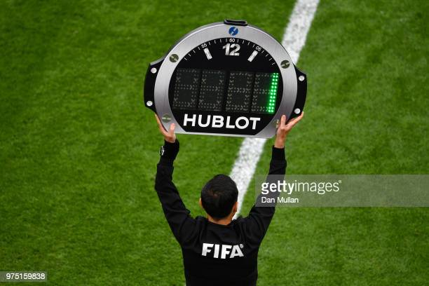 Fourth Official Milorad Mazic uses the LED Board to indicated 1 minute of added time during the 2018 FIFA World Cup Russia group A match between...
