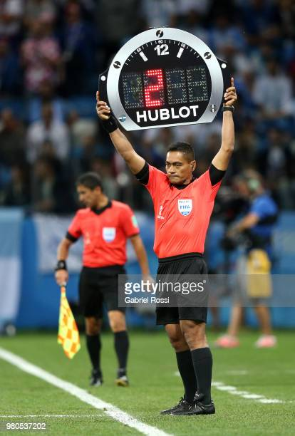Fourth Official Norbert Hauata shows the extra time of the first half during the 2018 FIFA World Cup Russia group D match between Argentina and...