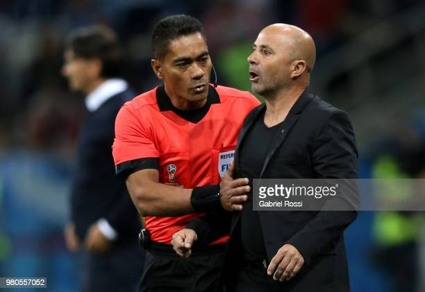 Fourth Official Norbert Hauata speaks with Jorge Sampaoli Head coach of of Argentina during the 2018 FIFA World Cup Russia group D match between...