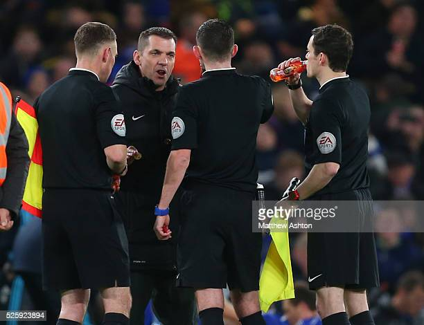 Fourth official Phil Dowd speaks with referee Michael Oliver