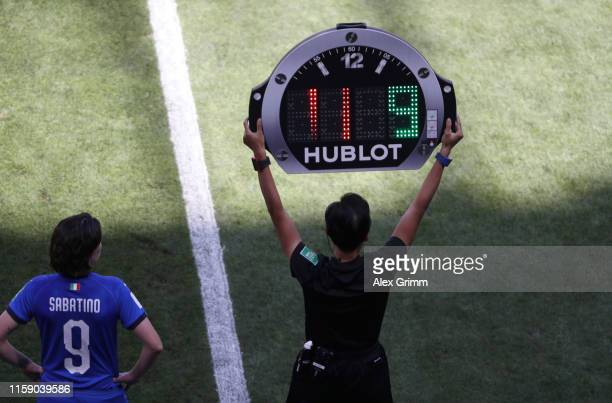 Fourth Official Qin Liang holds up the substitution board as Daniela Sabatino of Italy prepares to come on during the 2019 FIFA Women's World Cup...