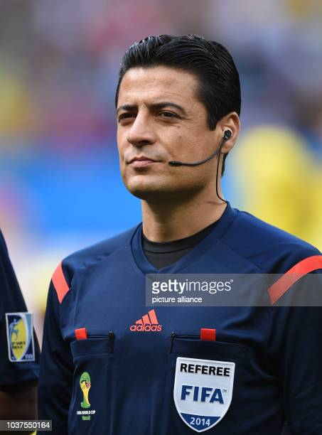 Fourth official referee Alireza Faghani of Iran seen during the FIFA World Cup 2014 round of 16 match between France and Nigeria at the Estadio...