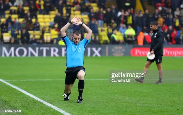 Fourth official Tom Neild warms up as he prepares to replace assistant referee Darren Cann during the Premier League match between Watford FC and AFC...