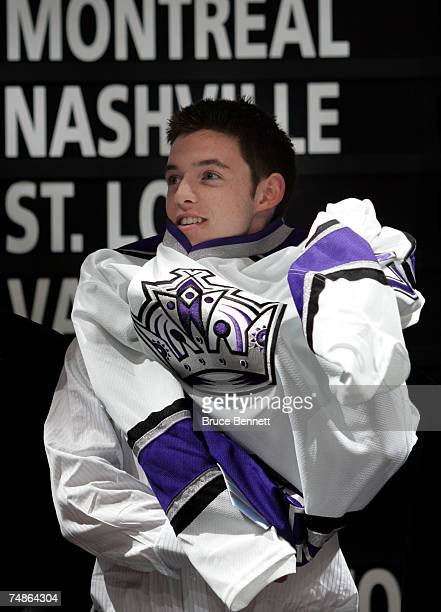 Fourth overall pick Thomas Hickey of the Los Angeles Kings puts on his new jersey after being drafted in the first round of the 2007 NHL Entry Draft...