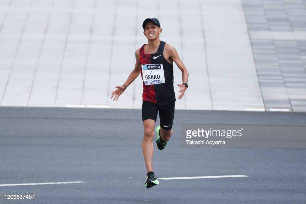 Fourth place and new Japanese national record holder Suguru Osako of Japan approaches the finish line in the men's competition during the Tokyo...
