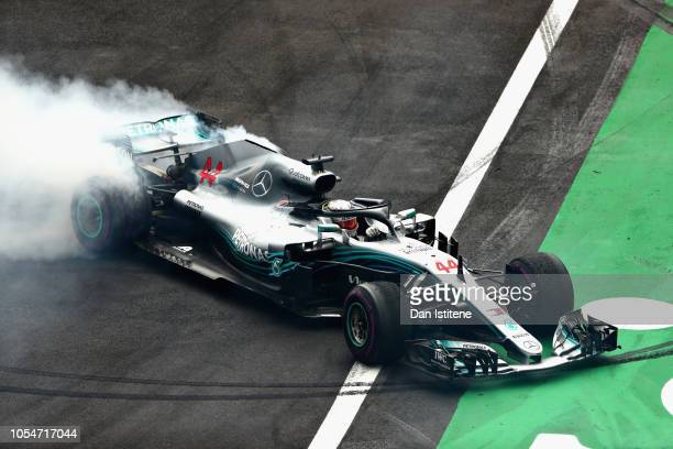 Fourth place finisher Lewis Hamilton of Great Britain and Mercedes GP celebrates winning the 2018 F1 World Drivers Championship by performing donuts...