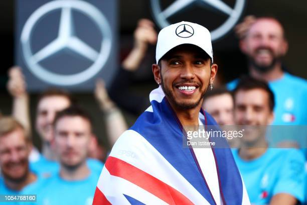 Fourth place finisher Lewis Hamilton of Great Britain and Mercedes GP celebrates winning the 2018 F1 World Drivers Championship with his team after...