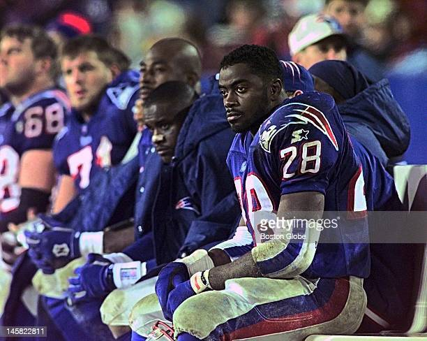 Fourth quarter action a view of the sidelines with Curtis Martin watches as the Patriots head for a loss against Green Bay
