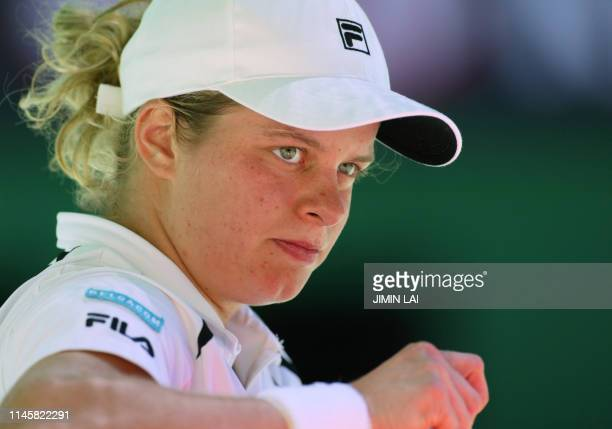 Fourth seeded Kim Clijsters of Belgium pauses between games against eighth seeded Anastasia Myskina of Russia in their women's singles quarterfinal...