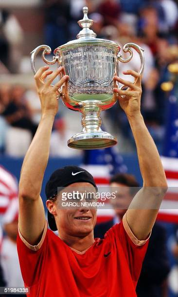 Fourth seeded Lleyton Hewitt of Australia holds up the champion's trophy during ceremonies after he defeated tenth seeded Pete Sampras in the men's...