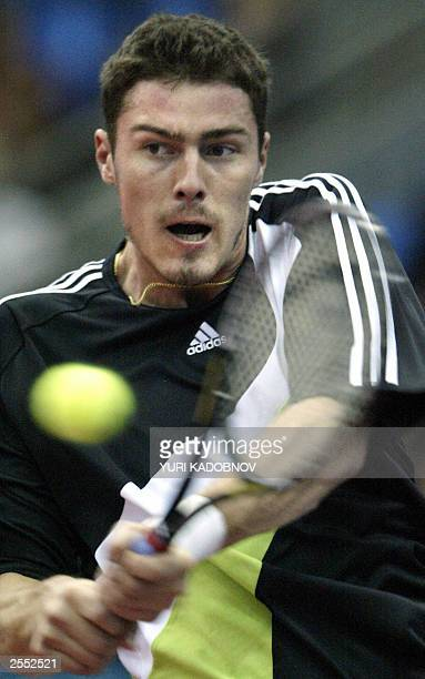 Fourth seeded Russian Marat Safin hits the ball from Zimbabwian Wayne Black during their match at the ATP men's Kremlin Cup tennis tournament held in...