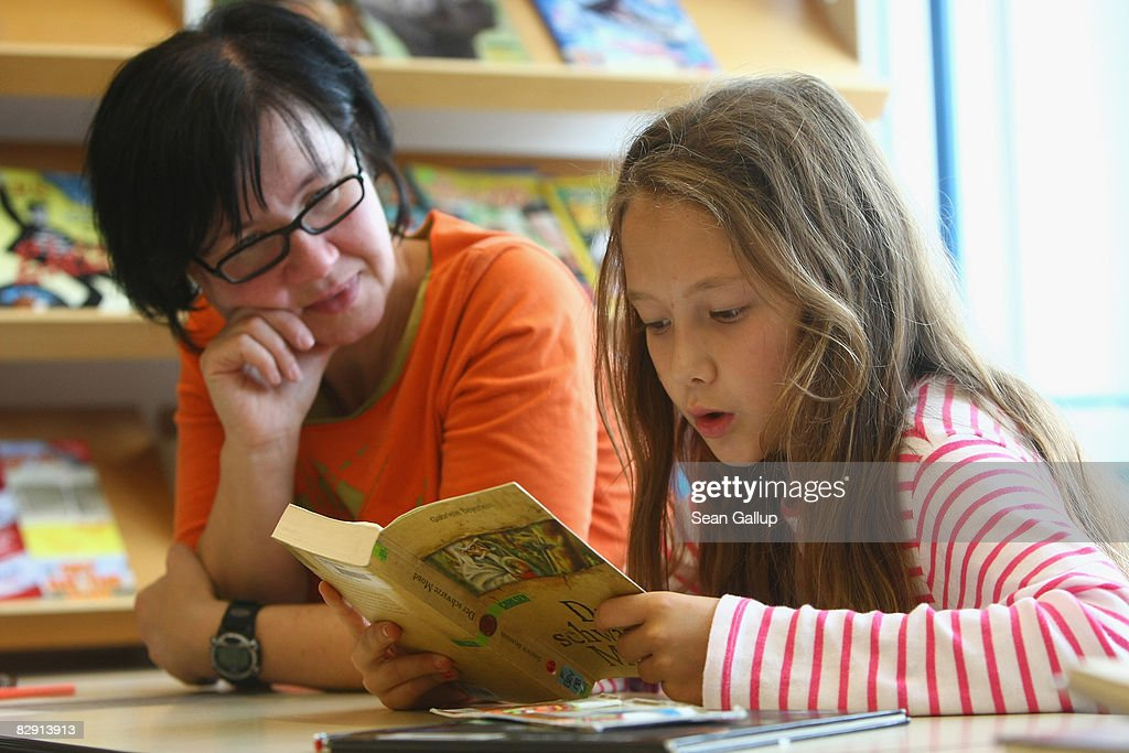 A fourth-grade student reads a book with her teacher in the elementary school at the John F. Kennedy Schule dual-language public school on September 18, 2008 in Berlin, Germany. The German government will host a summit on education in Germany scheduled for mid-October in Dresden. Germany has consistantly fallen behind in recent years in comparison to other European countries in the Pisa education surveys, and Education Minister Annette Schavan is pushing for an 8 percent increase in the national educaiton budget for 2009.