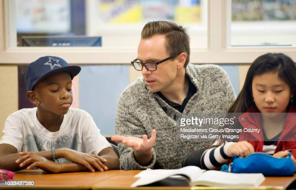 Fourthgrade teacher Chris McNatt works with Jie Jordan and Christine Chang both 9 at Stonegate Elementary School in Irvine shot 020314...