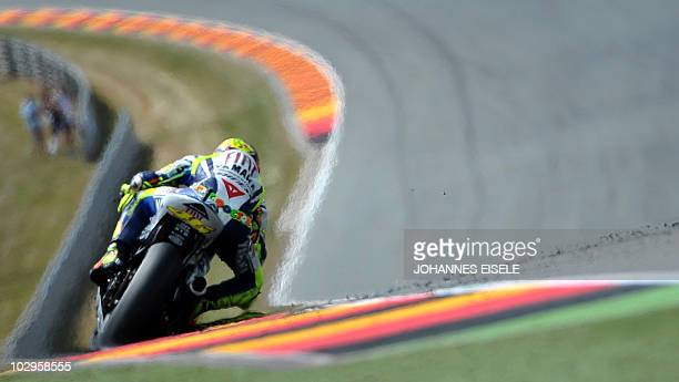 Fourthplaced Yamaha driver Valentino Rossi of Italy steers his bike during the race of the Moto Grand Prix of Germany at Sachsenring Circuit on July...