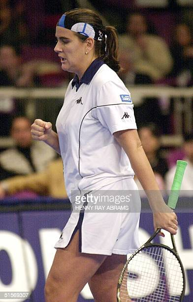 Fourthseeded Conchita Martinez of Spain celebrates after beating unseeded Elena Likhovtseva of Russia in their opening round match at the Chase...