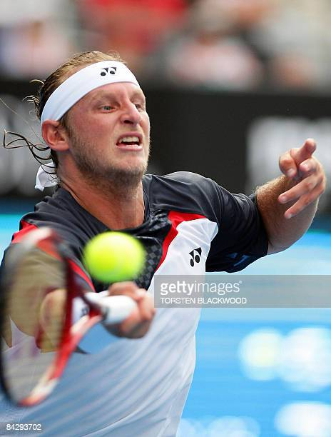 Fourth-seeded David Nalbandian of Argentina lunges for a forehand return to Lleyton Hewitt of Australia during the quarter-finals of the Sydney...