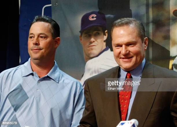 Fourtime Cy Young Award winning pitcher Greg Maddux and his agent Scott Boras appear at a news conference to announce Maddux' retirement from Major...