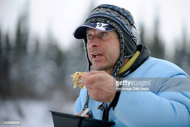 Fourtime Iditarod champion Martin Buser eats at the checkpoint in Nikolai Alaska during the Iditarod Trail Sled Dog Race on Tuesday March 6 2012